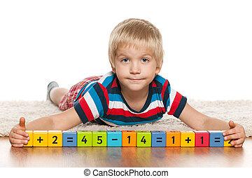 Blond preschool boy with blocks