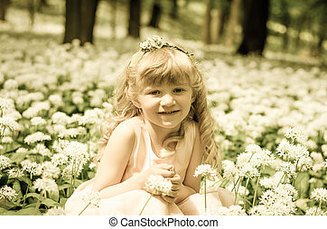 blond princess in white meadow in woods