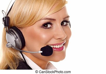Blond receptionist . - A beautiful young woman talking on a ...