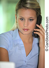 Blond receptionist taking a call