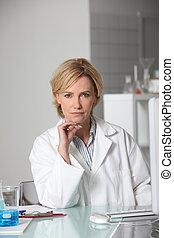 Blond scientist in laboratory