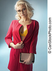 Blond sensual lady holding a purse