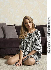 blond sexy girl sitting on carpet