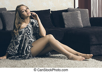 blond sexy girl sitting on floor