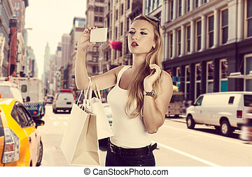 Blond shopaholic tourist girl selfie photo NYC Soho