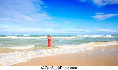 Blond Slim Girl in Red Runs into Surf Makes Selfie