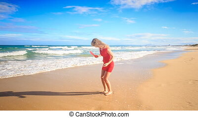 Blond Slim Girl Jumps Plays with Red Heart on Surf in Red