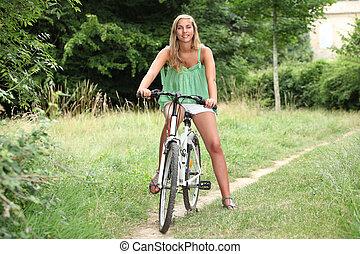 Blond teenage girl on bike ride