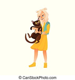 Blond teenage girl standing and holding black cat