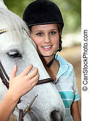 Blond teenage horse rider