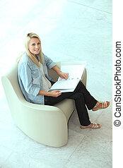 Blond teenager revising