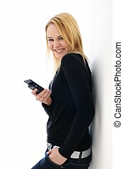 Blond teenager with mobile phone