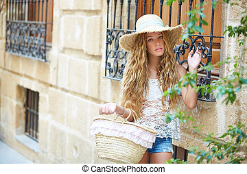 Blond tourist girl in mediterranean old town