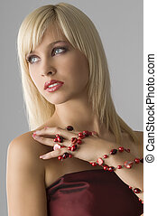 cute blond girl with glamor make up with red necklace