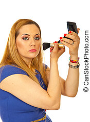 Blond woman apply blush