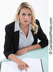 Blond woman checking diary for free appointments