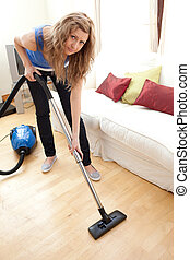 Blond woman cleaning the floor