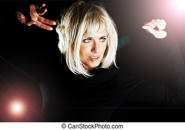 blond woman dancing in the dark