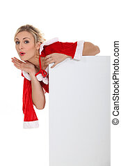 Blond woman dressed in Christmas outfit