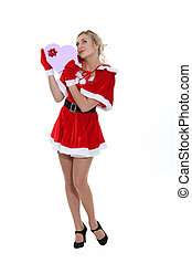 Blond woman dressed in suggestive Christmas costume