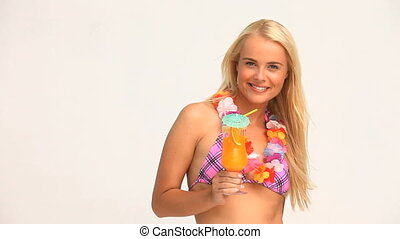 Blond woman drinking a cocktail