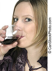 Blond woman drinking red wine