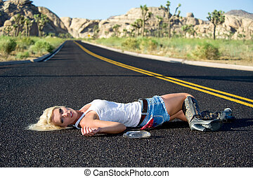 Blond woman drunk laying on highway