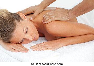 Blond woman enjoying a massage