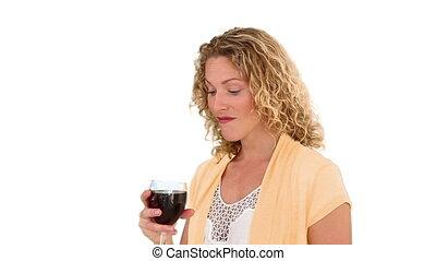 Blond woman enjoying glass of red wine