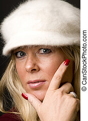 blond woman head shot with fashion hat