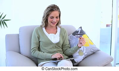 Blond woman holding a credit card