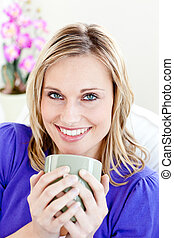 blond woman holding a cup of coffee