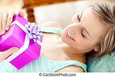 Blond woman holding a gift