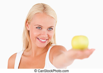 Blond woman holding an apple