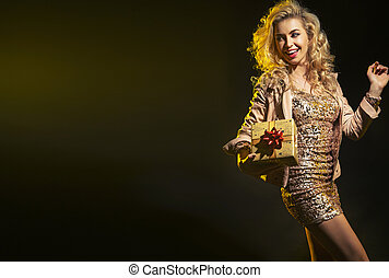 Blond woman holding birthday gift