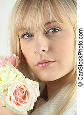 Blond woman holding flowers