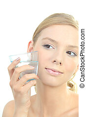 Blond woman holding glass of water to face
