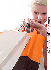Blond woman holding shopping bags