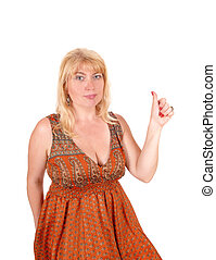 Blond woman holding thumb up.
