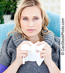 blond woman holding tissue