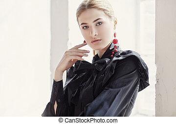 Blond woman in a black dress.
