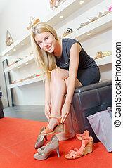 Blond woman in a shoe shop