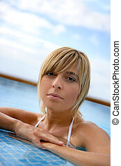 Blond woman in a swimming-pool