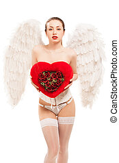 blond woman in angel costume holding heart - young blond...