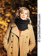 Blond woman in autumn forest