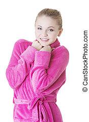 Blond woman in bathrobe