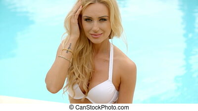 Blond Woman in Bikini Flirting with Camera