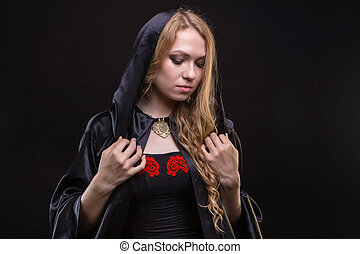 Blond woman in black hood