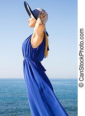 Blond woman in blue