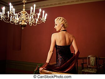 Blond woman in evening dress.